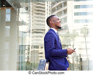 Smiling young businessman in the city