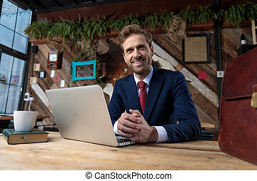 smiling young businessman touching hands in coffeeshop