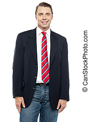Smiling young businessperson posing casually