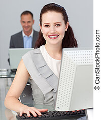 Smiling young businesswoman looking at the camera