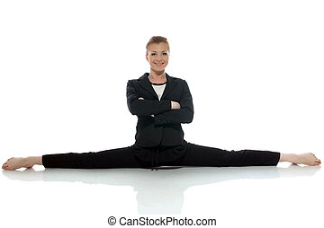 Smiling young businesswoman sitting on split