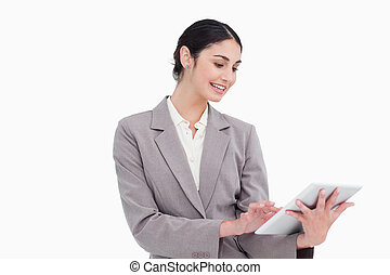 Smiling young businesswoman using tablet computer