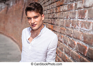 Smiling young casual man looking at the camera