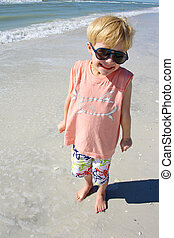 Smiling Young Child on Beach