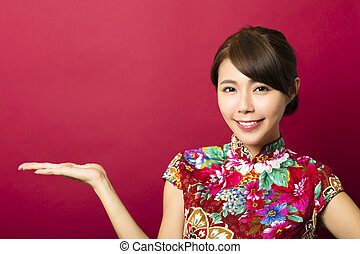smiling young chinese woman with showing gesture