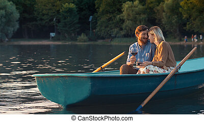 Smiling young couple in a boat