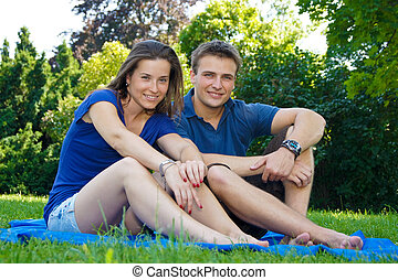 Smiling young couple in nature