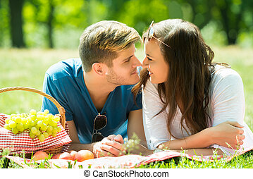Smiling Young Couple Looking At Each Other