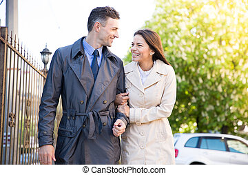 Smiling young couple walking outdoors