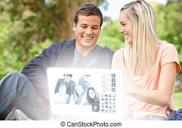 Smiling young couple watching photo