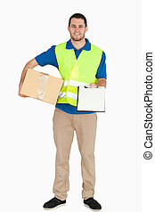 Smiling young delivery man asking for signature