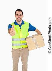 Smiling young delivery man giving approval