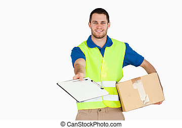 Smiling young delivery man with parcel asking for signature