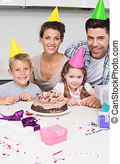 Smiling young family celebrating a birthday together