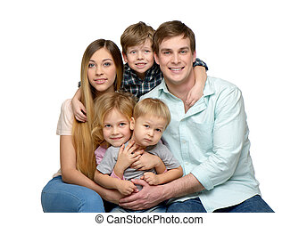 Smiling young family of five enjoying time together