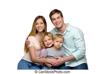 Smiling young family of four enjoying time together