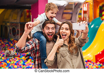 Smiling young family with their little son