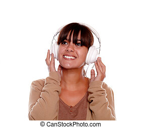 Smiling young female looking up with headphones