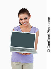 Smiling young female with her laptop