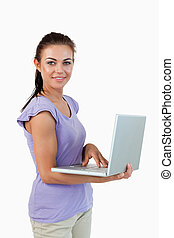 Smiling young female with laptop