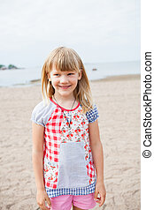 Smiling young girl at beach