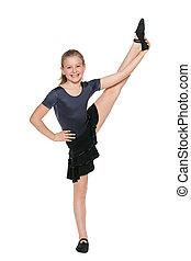 Smiling young girl dancing