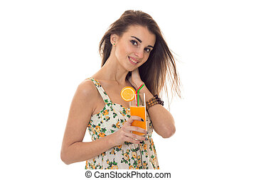 smiling young girl holds in her hand a glass of orange juice