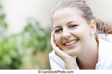 smiling young girl on natural background