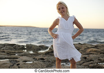 young girl on ocean - smiling young girl on ocean coast line