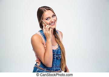 Smiling young girl talking on the phone