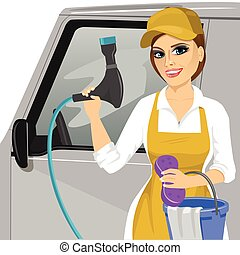 Smiling young girl with a soapy sponge and hose to wash a car
