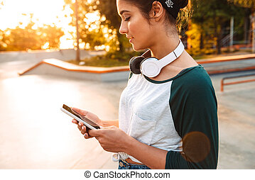 Smiling young girl with headphones