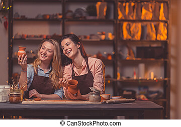 Smiling young girls at work