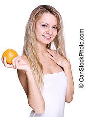 woman holding the orange