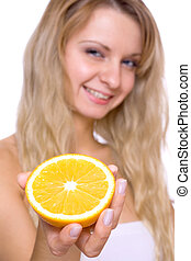 woman holding the orange
