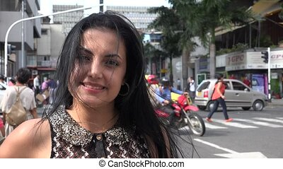 Smiling Young Hispanic Woman in Urban Area