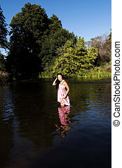 Smiling Young Japanese American Woman Standing In River