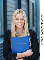 Smiling young job applicant with her CV