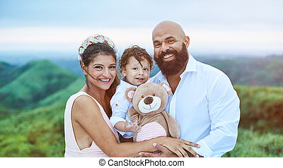 Smiling young latino family