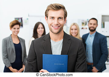 Smiling young male job applicant - Successful smiling young...