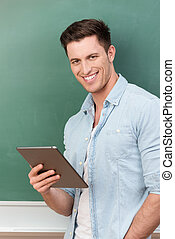 Smiling young man holding a tablet