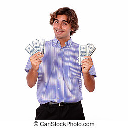 Smiling young man holding cash dollars