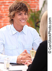 Smiling young man in a restaurant