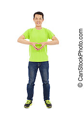 smiling young man make a heart gesture