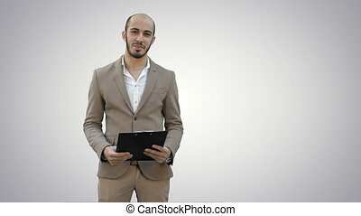 Smiling young man making business presentation on white background.
