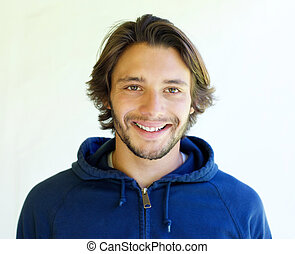 Smiling young man on white background