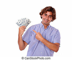 Smiling young man pointing cash dollars