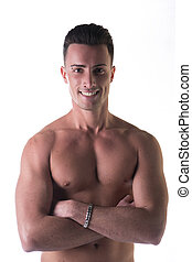 Smiling young man shirtless, arms crossed on bare chest