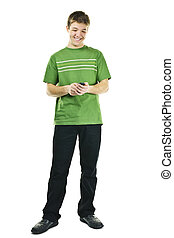 Smiling young man texting on mobile phone