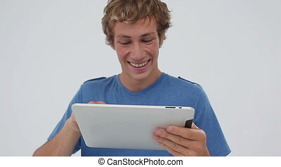 Smiling young man using a tablet computer